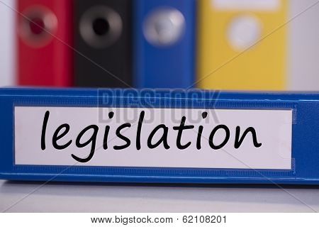 The word legislation on blue business binder