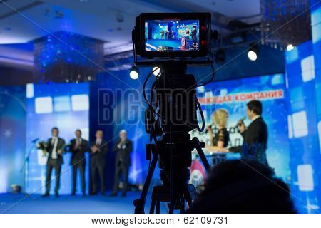 RUSSIA, MOSCOW - DEC 11, 2013: Camcorder recording presentation title Company of the Year 2013 in Lotte Plaza Hotel. Organizer - Rosbusinessconsulting.