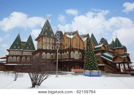 RUSSIA, MOSCOW - DEC 22, 2013: Reconstructed wooden palace of Tsar Alexei Mikhailovich with Christmas tree