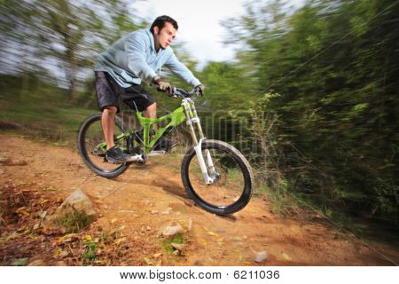 A young man riding a mountain bike