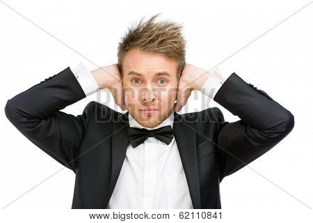 Half-length portrait of business man closes his ears, isolated on white. Concept of noise and stress