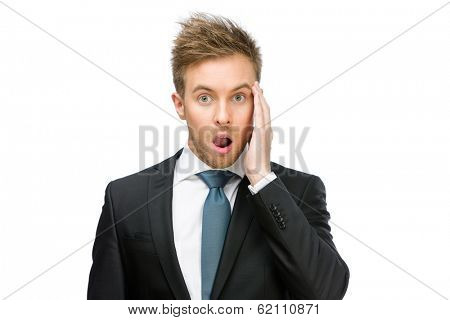 Half-length portrait of amazed businessman with open mouth who touches face, isolated on white