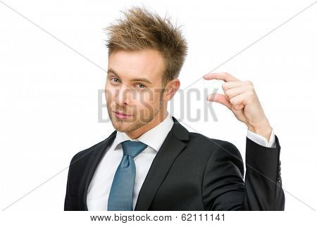 Portrait of manager showing small amount of something, isolated on white