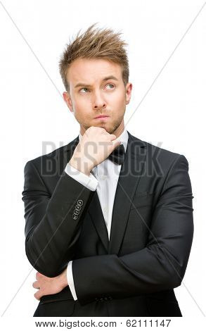 Half-length portrait of pensive businessman touching face, isolated on white. Concept of leadership and success