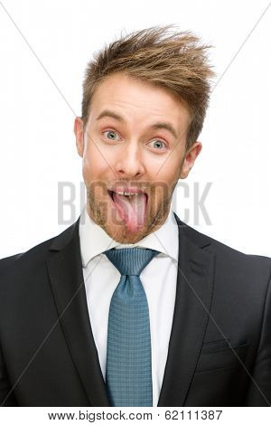 Frontal view of showing tongue businessman, isolated on white. Concept of fun and carefree