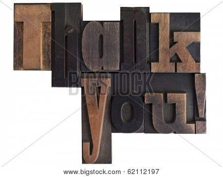 Phrase  - thank you! - in vintage wooden letterpress type, scratched and stained, isolated on white background