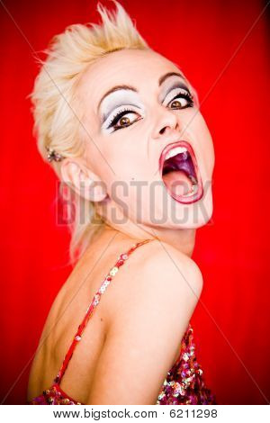 Screaming Furious Blond Woman With Pank Hairstyle