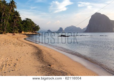 Tropical beach at sunset in El nido, Palawan, Philippines
