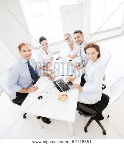 business concept - friendly business team having meeting in office
