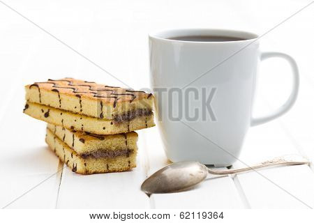 the coffee mug and sweet dessert