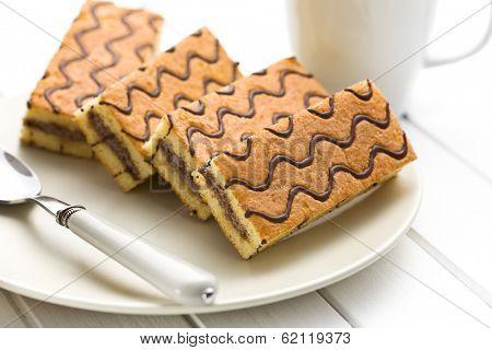 the sweet dessert on white wooden table