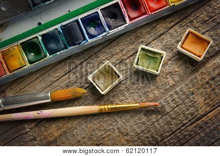 Professional watercolor aquarell paints in box with brushes