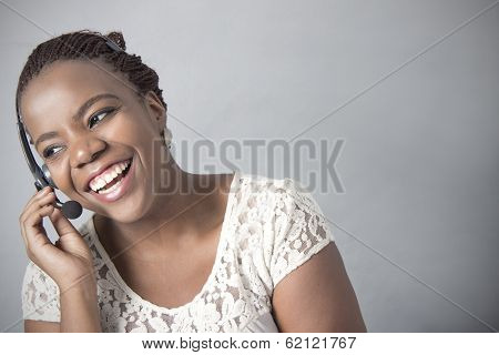 Young Black Call Centre Agent Laugh, talking
