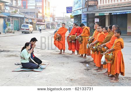 Vang Vieng, Laos - Feb 1: Monks Collect Alms During The Daily Procession