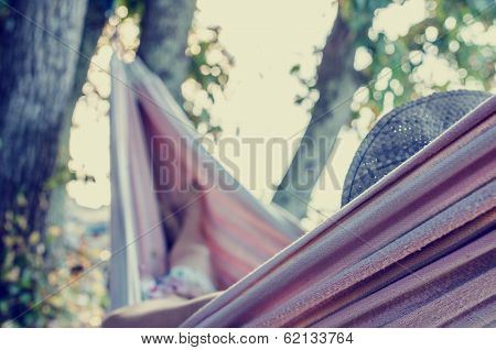 Vintage Toned Image Of A Woman In A Hammock