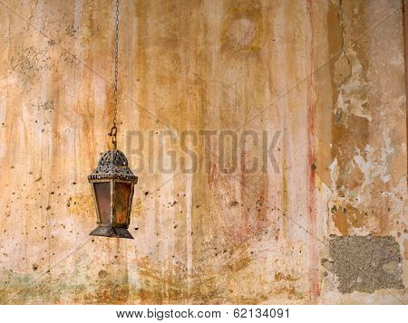 Incense in Greek orthodox church hanging at the wall