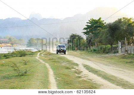 Vang Vieng, Laos - Feb 1: Local Car On A Rural Road On February 1, 2014 In Vang Vieng, Laos.