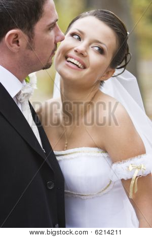 Laughing Beautiful Bride Close To Her Groom