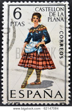 A stamp printed in Spain dedicated to Provincial Costumes shows a woman from Castellon