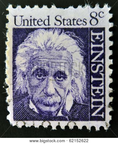 stamp shows Albert Einstein theoretical physicist who developed the theory of general relativity