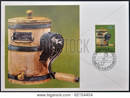 stamp dedicated to old alpine dairy farming implements shows Butter Churn