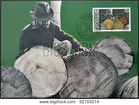 A stamp printed in Liechtenstein dedicated to Man and work shows forestry