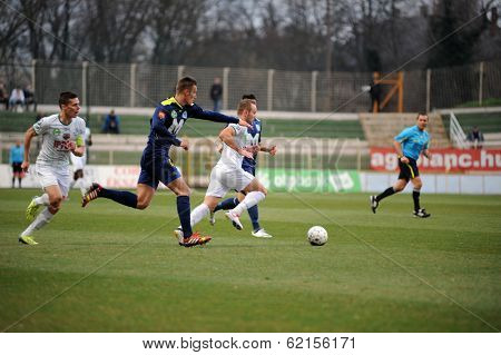 KAPOSVAR, HUNGARY - MARCH 16: Florean Andrei-Alexandru  (white) in action at a Hungarian Championship soccer game - Kaposvar (white) vs Puskas Akademia (blue) on March 16, 2014 in Kaposvar, Hungary.