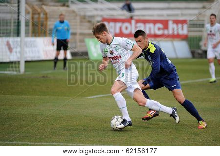 KAPOSVAR, HUNGARY - MARCH 16: Kink Tarmo (white 9) in action at a Hungarian Championship soccer game - Kaposvar (white) vs Puskas Akademia (blue) on March 16, 2014 in Kaposvar, Hungary.