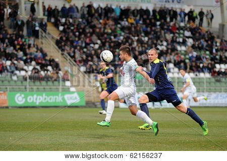 KAPOSVAR, HUNGARY - MARCH 16: Firtulescu Dragos Petrut (white 10) in action at a Hungarian Championship soccer game - Kaposvar (white) vs Puskas Akademia (blue) on March 16, 2014 in Kaposvar, Hungary.