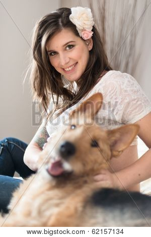 trendy pregnant woman with her pet dog