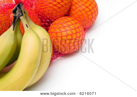 Bunches of Oranges and Bananas isolated on white