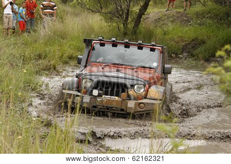 Crush Orange Jeep Rubicon Crossing Muddy Pond