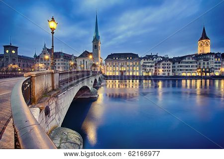 view on Fraumunster Church and Church of St. Peter at night, Zurich, Switzerland