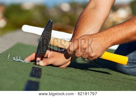 Man Hands Fastening Bitumen Roof Shingles
