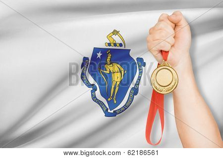 Medal In Hand With Flag On Background - Commonwealth Of Massachusetts. Part Of A Series.