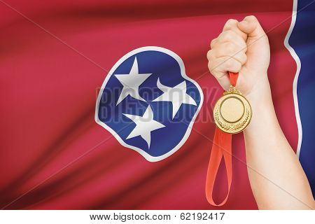 Medal In Hand With Flag On Background - State Of Tennessee. Part Of A Series.