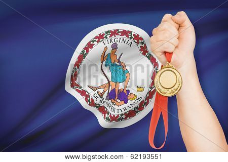 Medal In Hand With Flag On Background - Commonwealth Of Virginia. Part Of A Series.