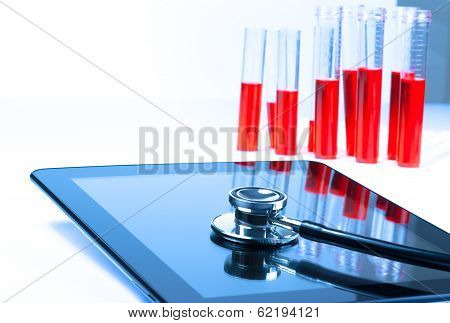 Detail Of Medical Stethoscope On Modern Digital Tablet Pc In Laboratory
