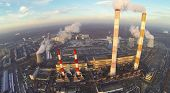 foto of chp  - Territory of power plant with chimneys with smoke at winter - JPG