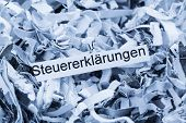 shredded paper tagged with tax returns, symbol photo for tax burden and retention requirements