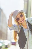 stock photo of stroll  - Portrait of happy young hipster in the city - JPG