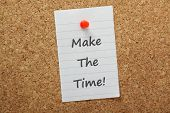 pic of time-piece  - The phrase Make The Time typed on a piece of paper and pinned to a cork notice board - JPG