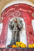 pic of laxmi  - God of Sun statue with saffron flowers in Laxmi Narayan temple or Birla Mandir in New Delhi India - JPG
