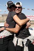 LOS ANGELES - MAR 15:  Tricia Helfer, Colin Egglesfield at the Toyota Grand Prix of Long Beach Pro-C