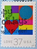 A stamp printed in USA shows hearts love
