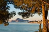stock photo of costa blanca  - Early morning take of the calm waters of Altea bay Costa Blanca Spain - JPG