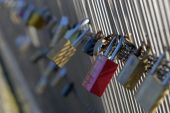 stock photo of leopold  - Locks of love on Paris bridge Leopold Sedar Senghor - JPG