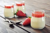 image of panna  - Dessert panna cotta with fresh strawberry on wooden background - JPG