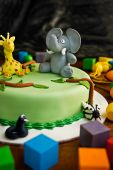 picture of birthday-cake  - Jungle themed birthday cake with an elephant and giraffe on top surrounded by building blocks - JPG