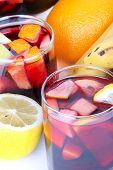 image of sangria  - Sangria in glasses and fruits on table closeup - JPG
